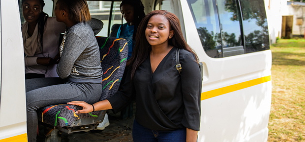 Freshman, Cynthia Chikozho, boards a bus to the campus outside the off-campus hostel where she lived in 2018..