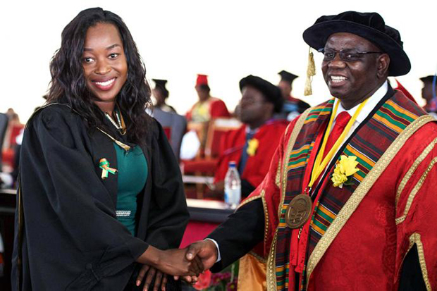 Gracious Matika gets a congratulatory handshake from the Vice Chancellor at the June 9 commencement.