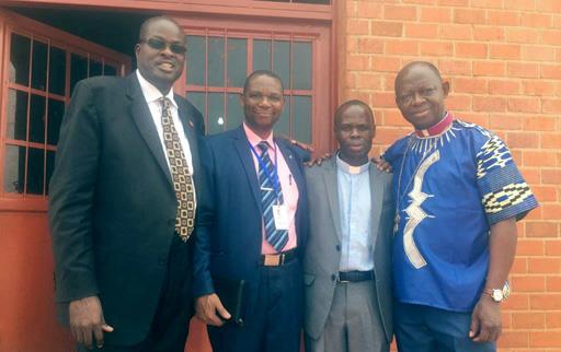 From left to right: Bishop Daniel Wandabula, Mr. Zepherin Ndikumana (AU pioneer graduate), Rev. Jean Ntahoturi, and Bishop John Yambasu.