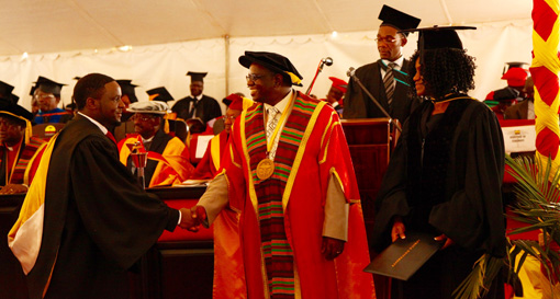Prof. Munashe Furusa, vice chancellor/CEO, congratulates a member of the graduating class of 2016.