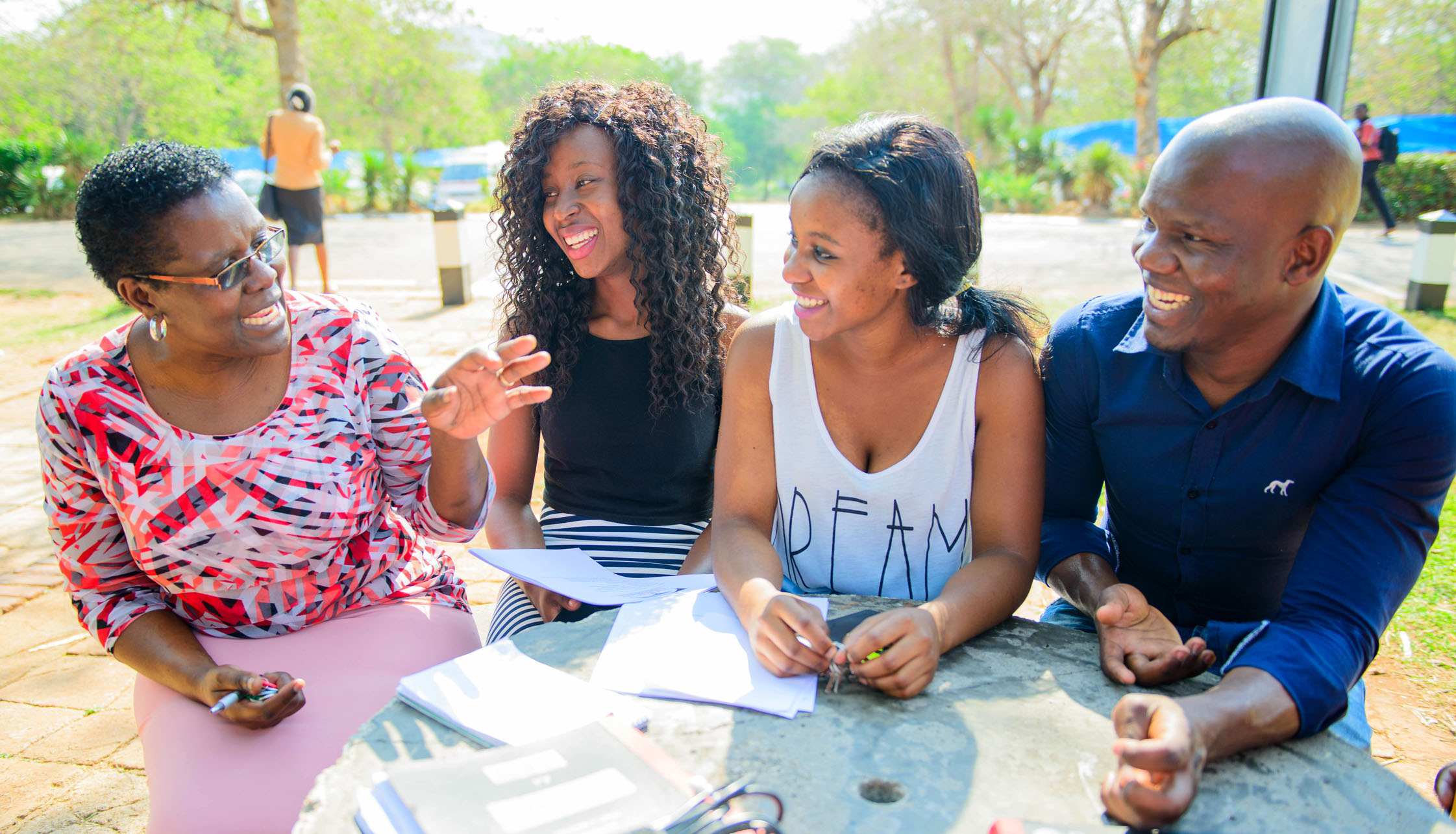 Dr. Mwazvita Machinga, (extreme left) in conversation with students.