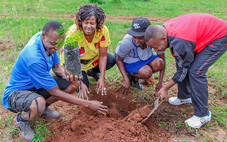 Dr. Furusa engages students and communities on creation care strategies such as tree-planting and waste recycling.