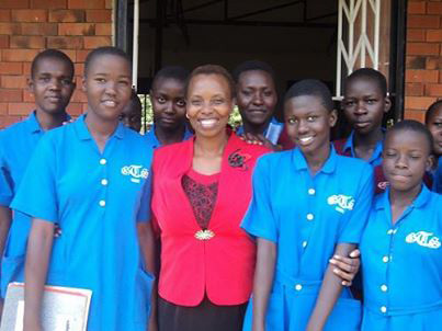 Nodumo Dhlamini, (center), with students following a careers event at Tororo Girls High School in Uganda.