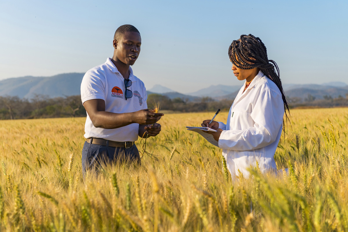 Ngaatendwe Murimba, Africa University graduate, with a current student at the Africa U farm.