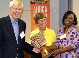 Dr. Kent Weeks and Mrs. Karen Weeks accepting the Drum Award from Board member Patricia Madondo in September 2014.