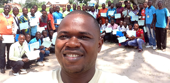 Pierre Omadjela takes a selfie with a group of trainees in the Central Congo Conference.